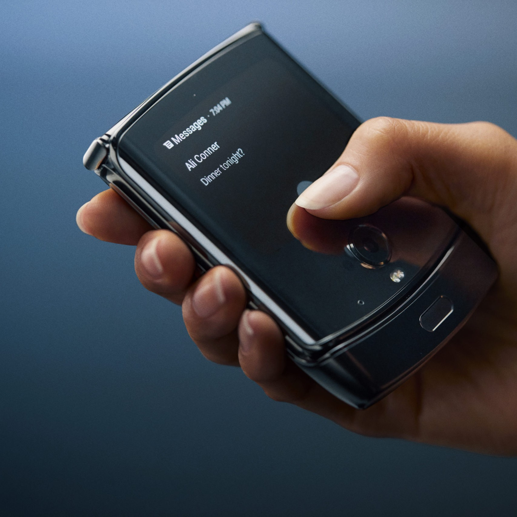 A hand holding Motorola Razr